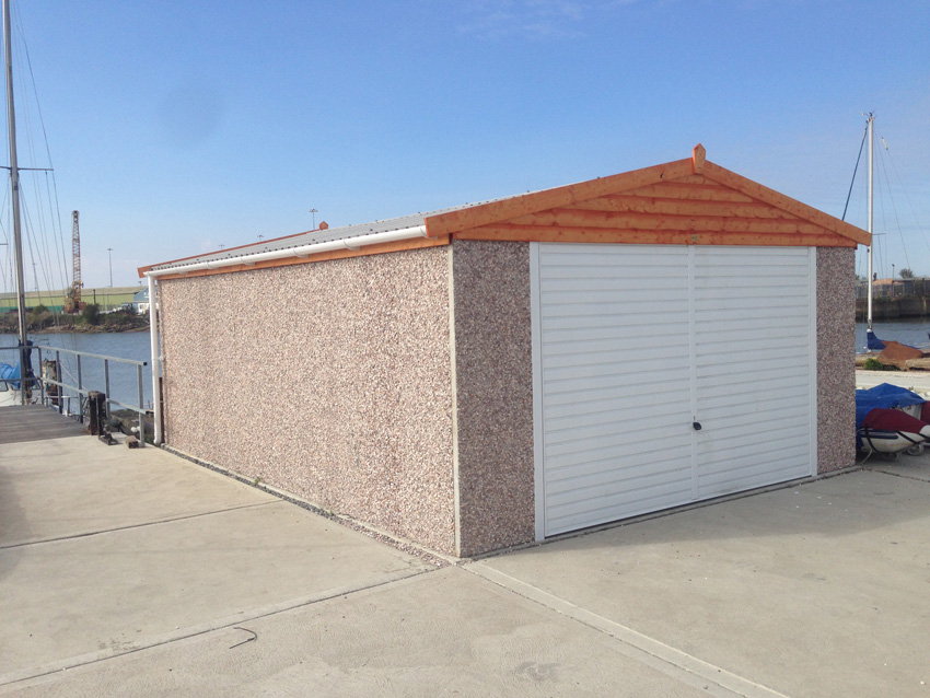 RWH concrete garages 01384864858 apex double concrete garage with,timber fascias.