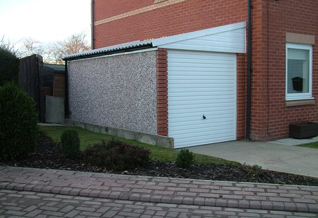 RWH concrete garages 01384864858.Lean to garage with brick fronts and upvc fascias .