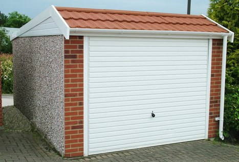 RWH concrete garages 01384 864858.Pent mansard concrete garage with brick fronts.